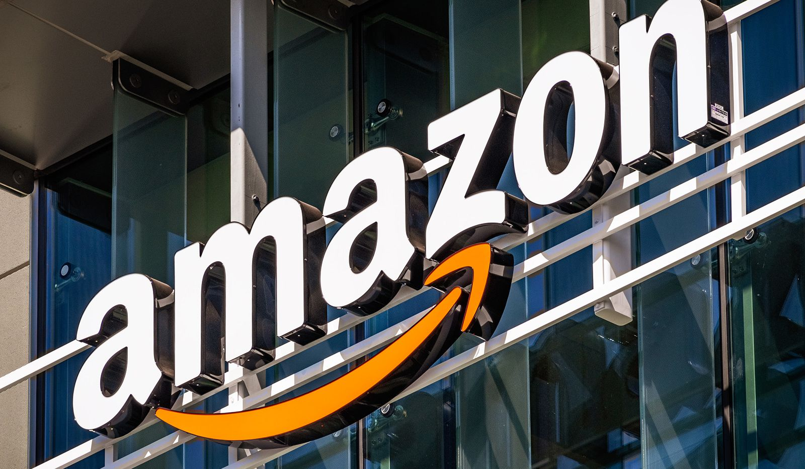 Amazon logo on an office building, but it could soon grace the front of department stores, according to a report in the Wall Street Journal Thursday.
