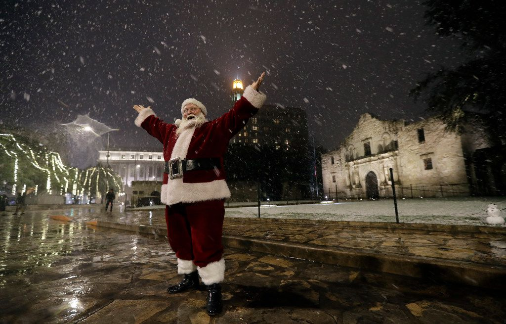 Dressed as Santa Claus, Eldon Hansen stands in front of the Alamo as snow falls in downtown San Antonio, Thursday, Dec. 7, 2017. The National Weather Service said up to 2.5 inches of snow had been measured in the San Antonio area. The most recent comparable snowfall in San Antonio was in January 1987, when 1.3 inches of snow accumulated, but the most recent major snowfall was 13.2 inches in January 1985.