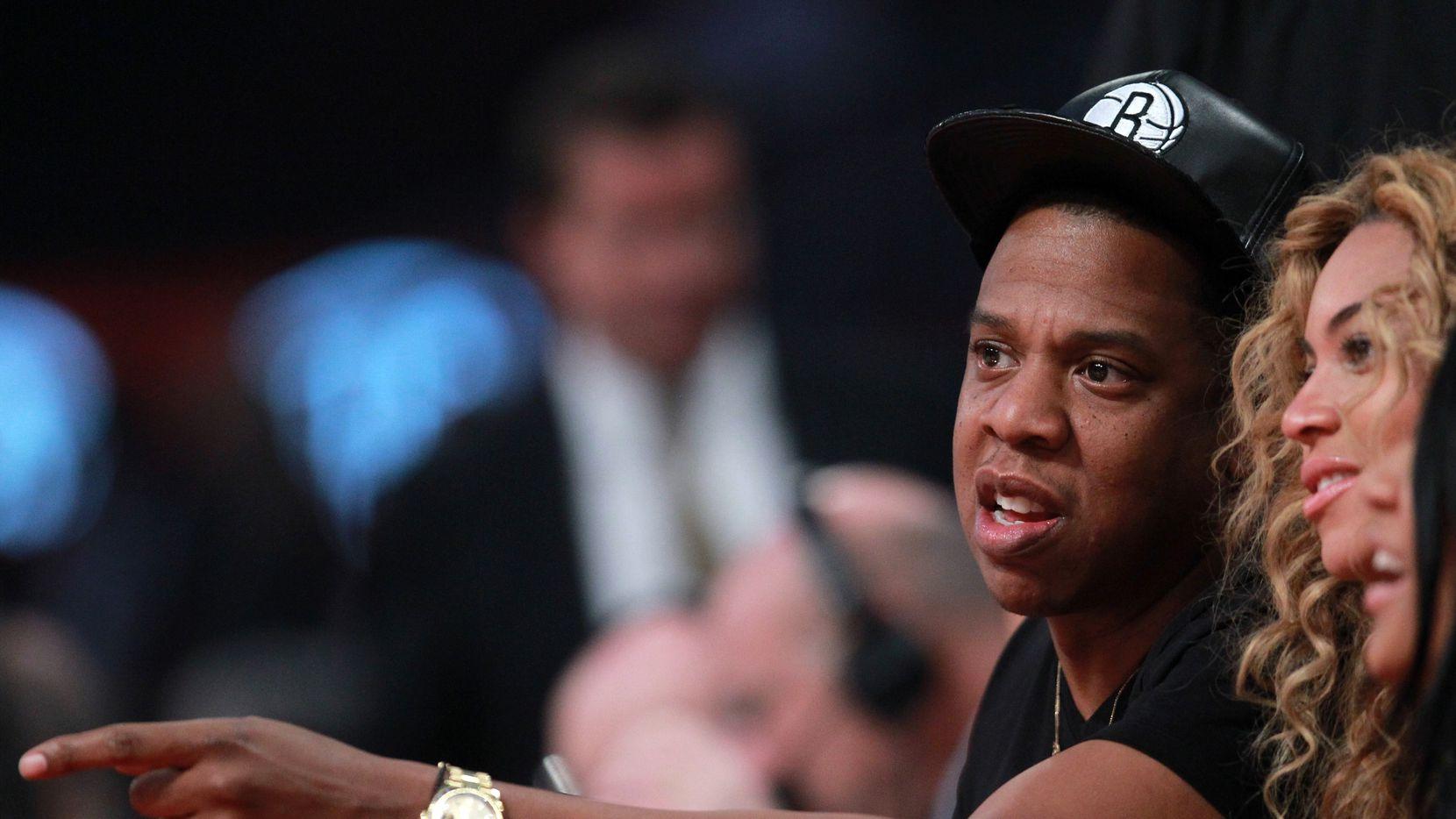 Jay-Z y Beyoncé en el Juego de las Estrellas de la NBA en 2013 en Houston.
