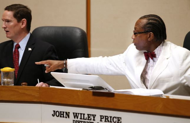 Dallas County Judge Clay Jenkins (left) and Commissioner John Wiley Price. Price is facing a federal corruption trial in February.