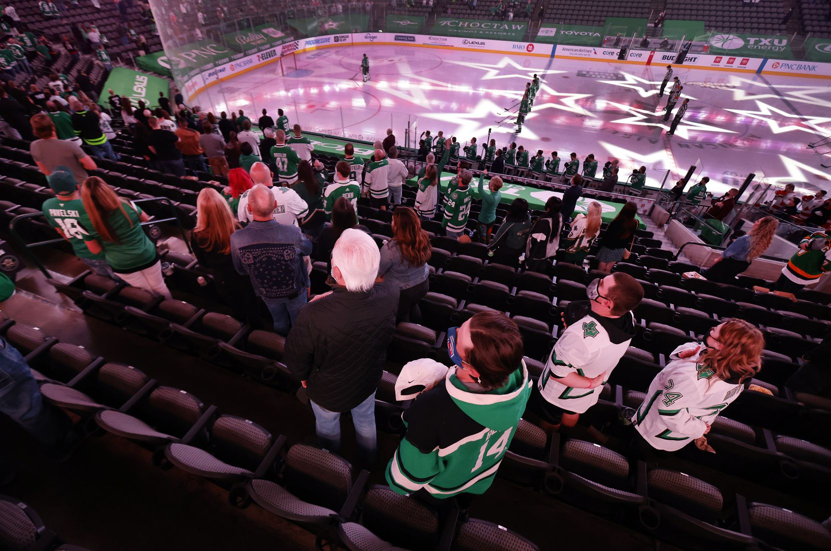 Dallas Stars fans stand for the national anthem during the last home game of the regular season at American Airlines Center on April 27.