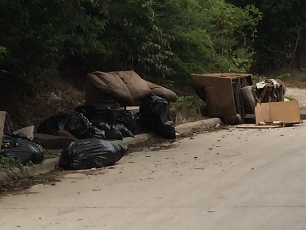 Illegal dumping in the 10th street Historic District at the corner of 10th and Cliff streets.