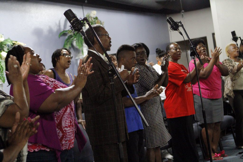 Members of the Cornerstone Baptist Church choir perform at A Taste of Gospel during the 12th Tulisoma South Dallas Book Fair and Arts Festival 2014 at Cornerstone Baptist Church in Dallas.