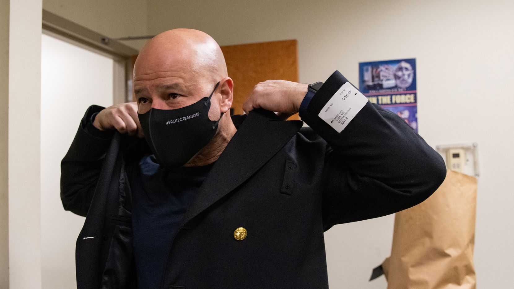 Dallas Police Chief Eddie Garcia tries on his uniform at DPD headquarters in Dallas on Tuesday, Feb. 1, 2021.