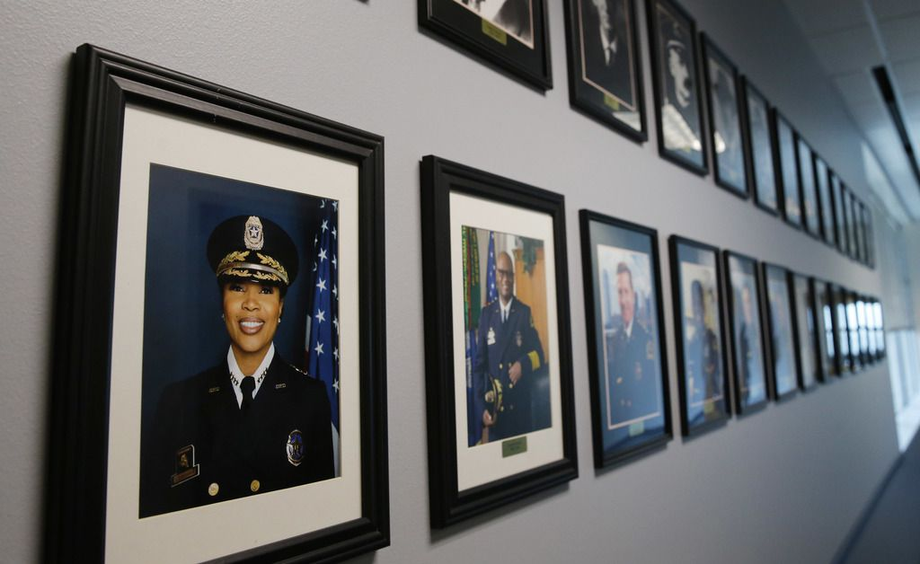 Dallas Police Chief U. Renee Hall's portrait next to past Dallas Police Chief's in a hallway at Dallas Police Department headquarters in Dallas, on Thursday, April 2, 2020.