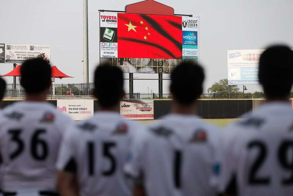 Texas AirHogs players (from left) Na Chuang, Song Yunqi, Yang Yanyong and Yang Jin), all of China, stand for the playing of the Chinese national anthem before a game at AirHogs Statdium in Grand Prairie, Texas.