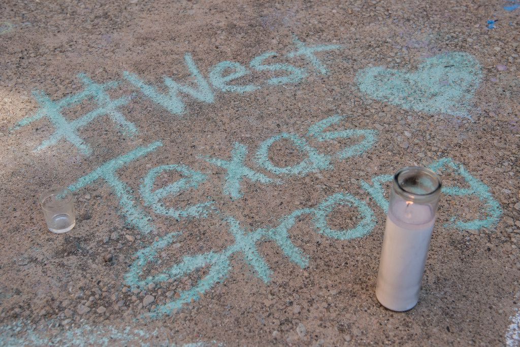 ODESSA, TX - SEPTEMBER 2: A chalk message at a memorial for victims of a mass shooting, at the University of Texas of the Permian Basin (UTPB) on September 2, 2019 in Odessa, Texas.
