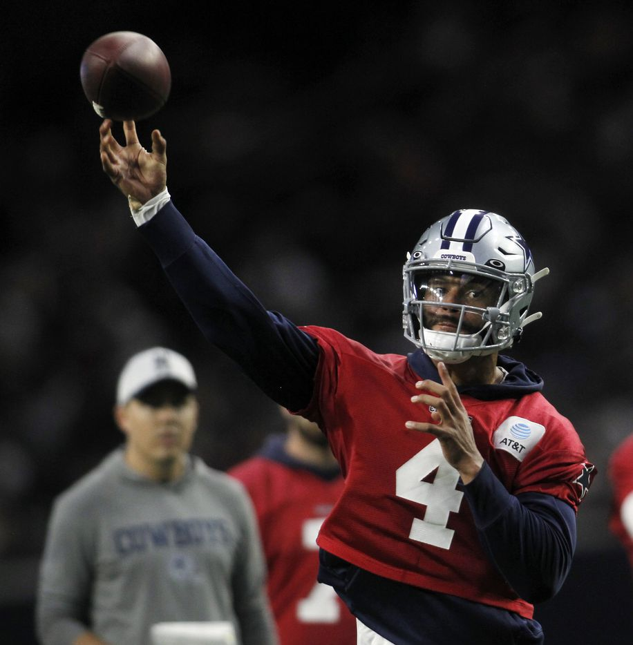 Dallas Cowboys quarterback Dak Prescott (4) launches a pass downfield during a team practice session. The Cowboys conducted their final public football practice session inside The Star at the Ford Center in Frisco on August 28, 2021. (Steve Hamm/ Special Contributor)