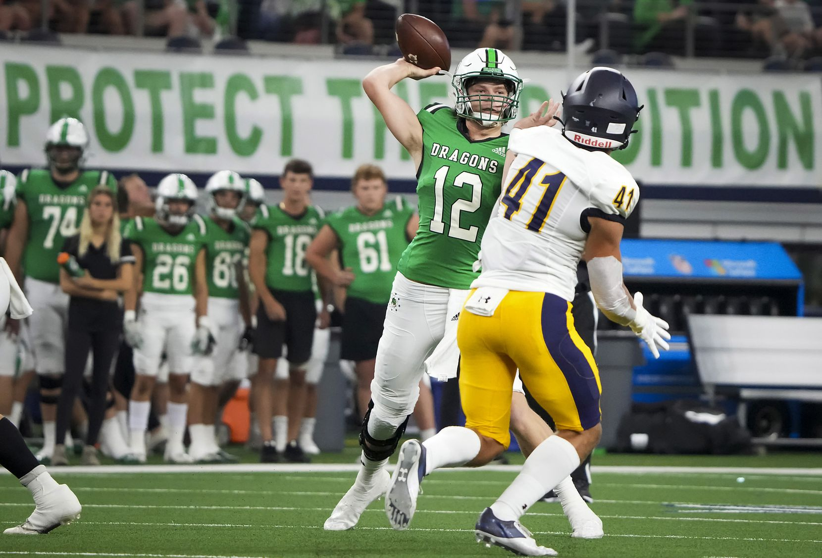 Southlake Carroll quarterback Kaden Anderson (12) throws a pass as Highland Park's George Wright (41) applies pressure during the first half of a high school football game at AT&T Stadium on Thursday, Aug. 26, 2021, in Arlington.