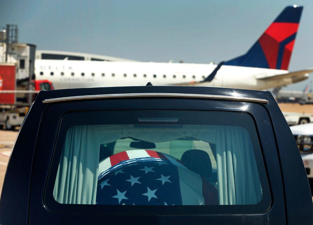 The remains of Seaman 1st Class George A. Coke Jr., of Arlington, rest in a hearse after they were unloaded from a commercial flight at Dallas-Fort Worth International Airport, Friday, June 23, 2017, Grapevine, Texas. Coke, who perished aboard the USS Oklahoma after it sank at Pearl Harbor, was identified through recent DNA testing. A service for Coke will be held at First United Methodist Church in central Arlington Saturday before being buried at Parkdale Cemetery.