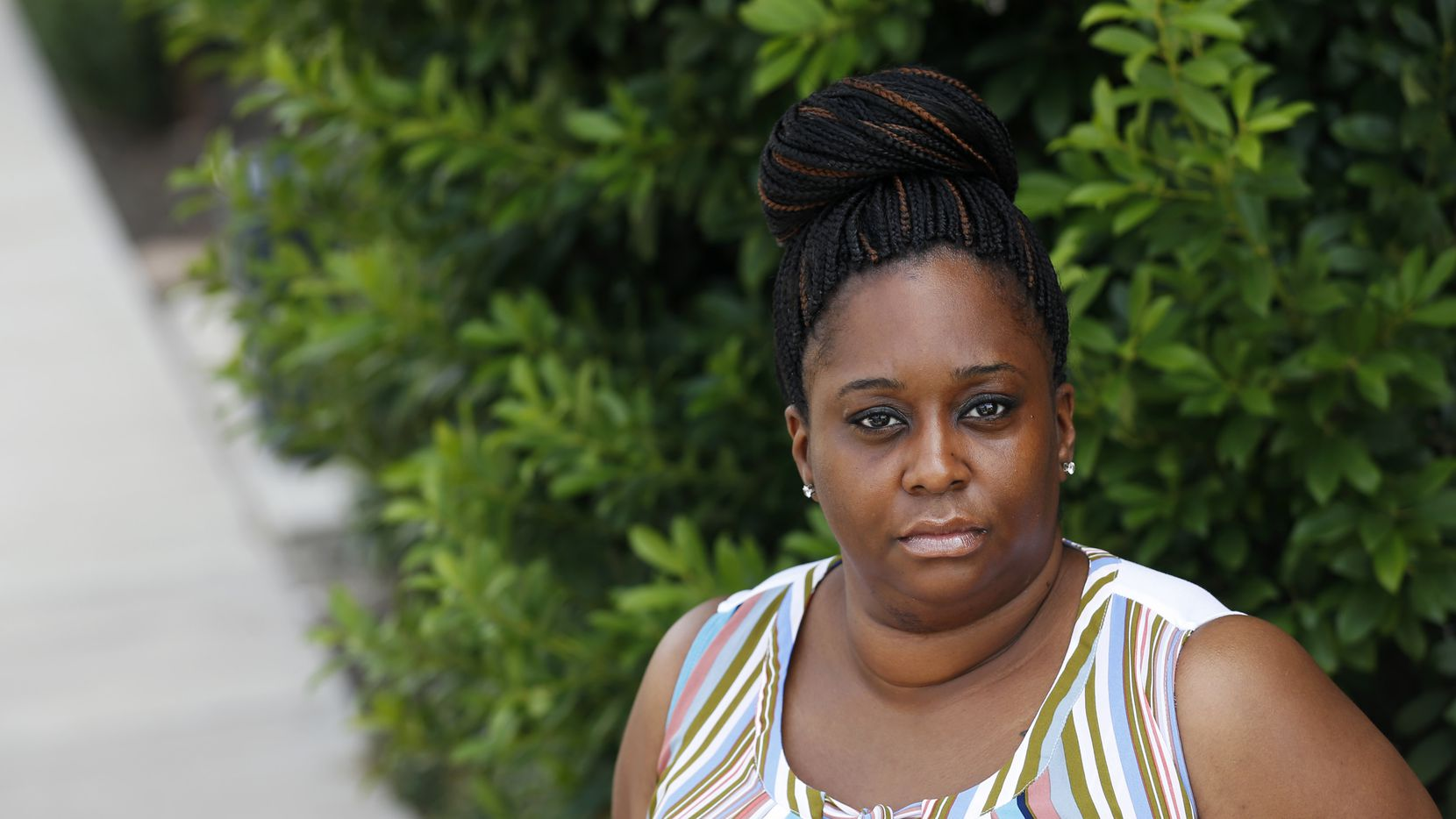 Sherry Tutt poses for a portrait at her apartment complex on Wednesday, July 1, 2020. Sherry's mother, Doris LaVon Sims, and her sister, LaKecial Tutt, both died of the coronavirus on June 9.