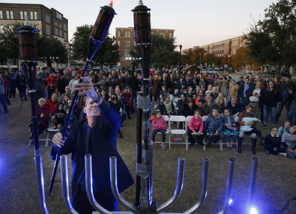 A menorah is lighted during a ceremony hosted by Chabad of Frisco at Frisco City Hall in Frisco.