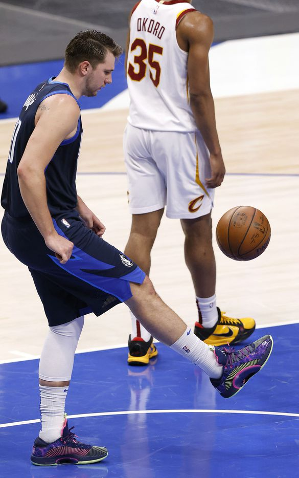 Dallas Mavericks guard Luka Doncic (77) kicks the ball soccer style as he picks it after being fouled by the Cleveland Cavaliers in the second quarter at the American Airlines Center in Dallas, Friday, May 7, 2021. (Tom Fox/The Dallas Morning News)
