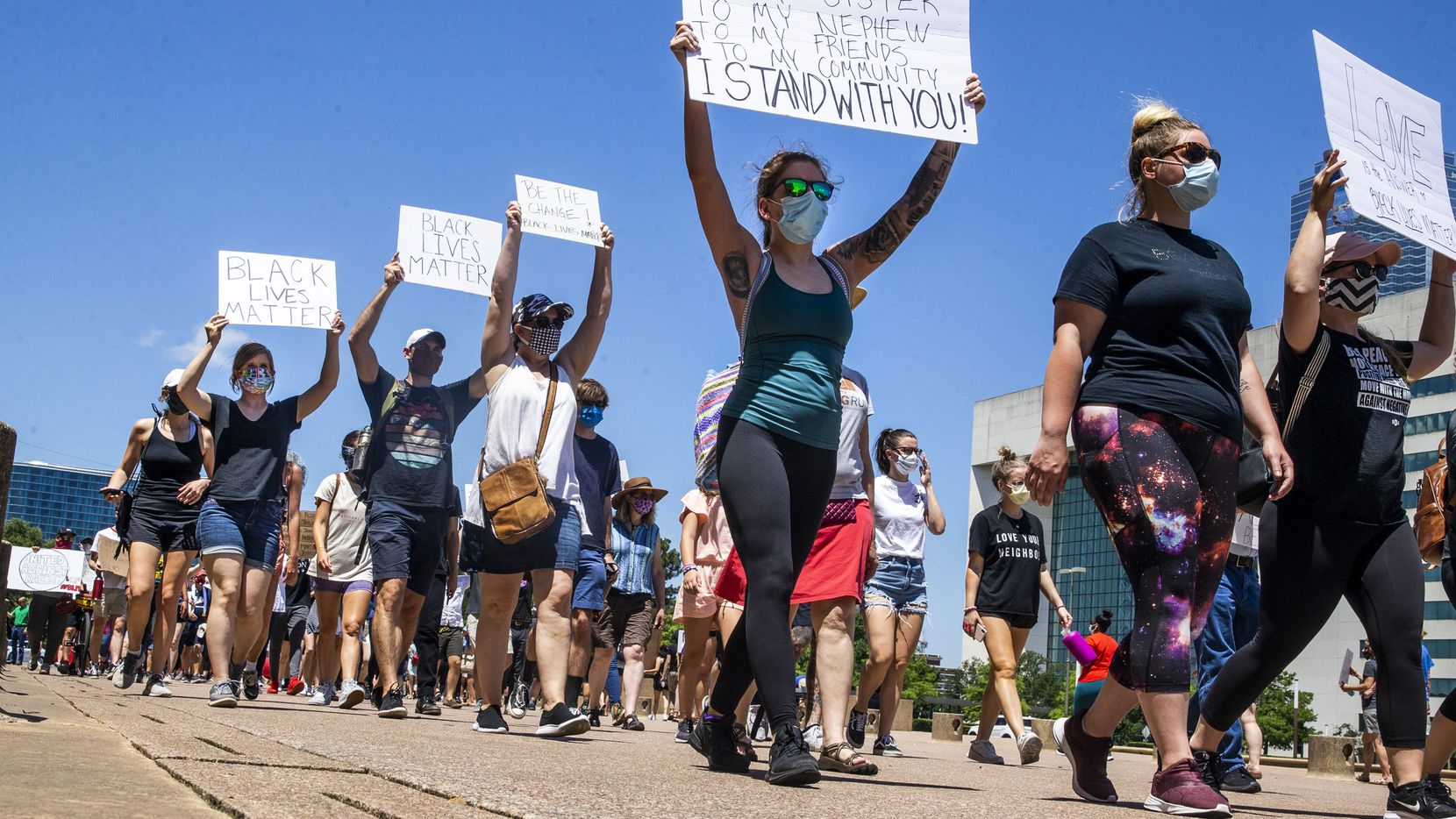 Protesters march in a silent demonstration at Dallas City Hall to denounce police brutality and systemic racism in Dallas on Thursday, June 4, 2020. The demonstration took place on the seventh day of organized protests in response to the recent deaths of George Floyd in Minneapolis and Breonna Taylor in Louisville.