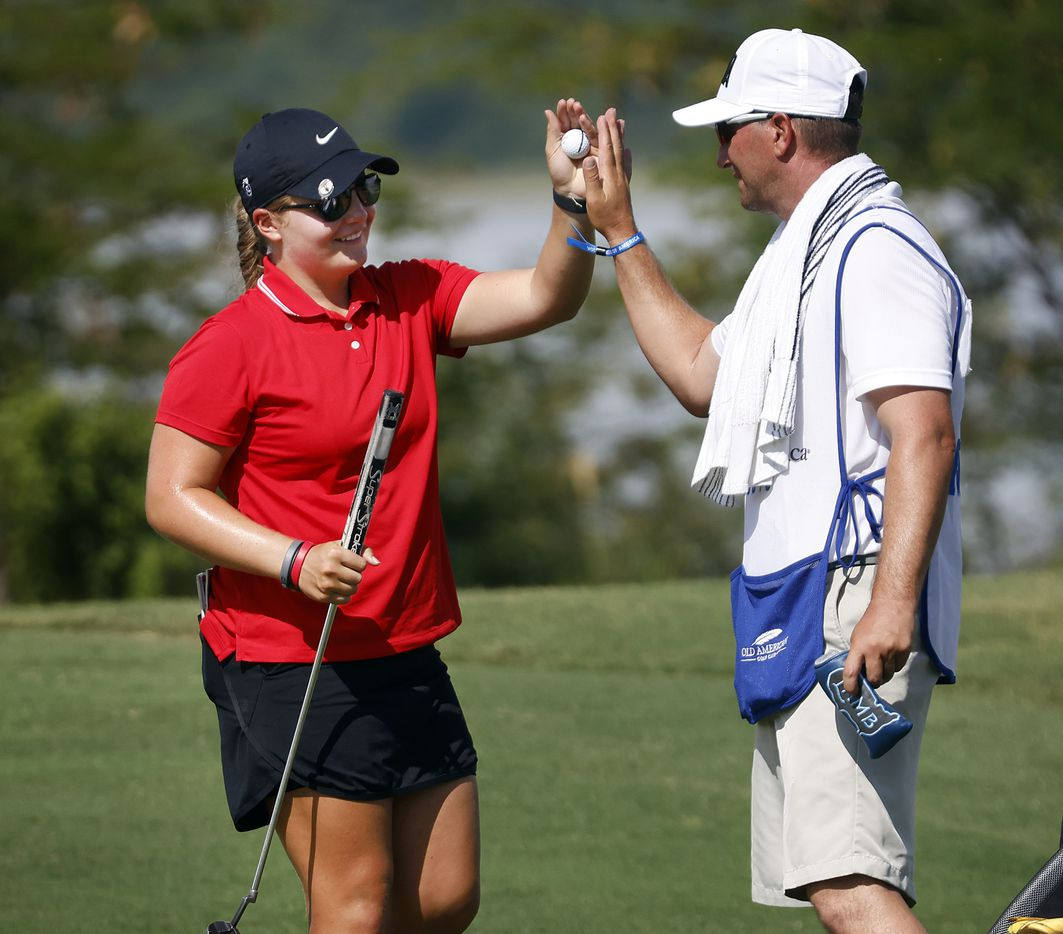 Amateur golfer Avery Zweig, 14, of McKinney (left) receives a high-five from her caddie Adam Golob after carding her first birdie of the LPGA VOA Classic at the Old American Golf Club in The Colony, Texas, Thursday, July 1, 2021. The putt came on No. 10 during the opening roun. (Tom Fox/The Dallas Morning News)