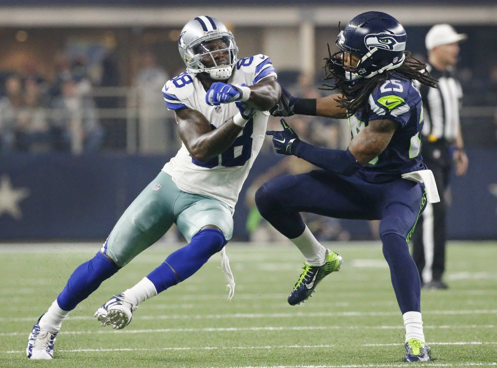 Dallas Cowboys wide receiver Dez Bryant (88) and Seattle Seahawks cornerback Richard Sherman (25) fight for positioning as Brynt runs a route in the third quarter during the Seattle Seahawks vs. the Dallas Cowboys NFL football game at AT&T Stadium in Arlington on Sunday, November 1, 2015. (Louis DeLuca/The Dallas Morning News)