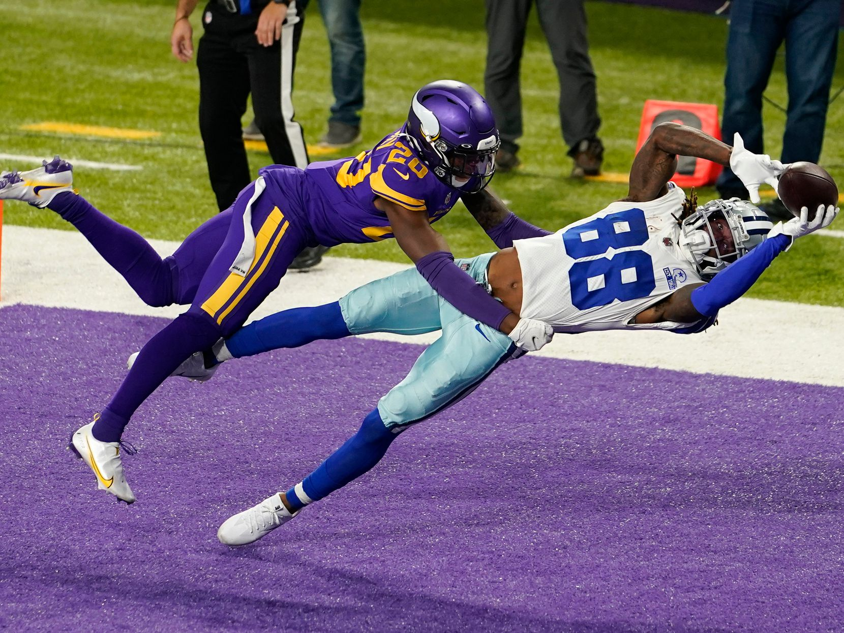Dallas Cowboys wide receiver CeeDee Lamb catches a 4-yard touchdown pass ahead of Minnesota Vikings cornerback Jeff Gladney, left, during the first half of an NFL football game in Minneapolis on Nov. 22, 2020.