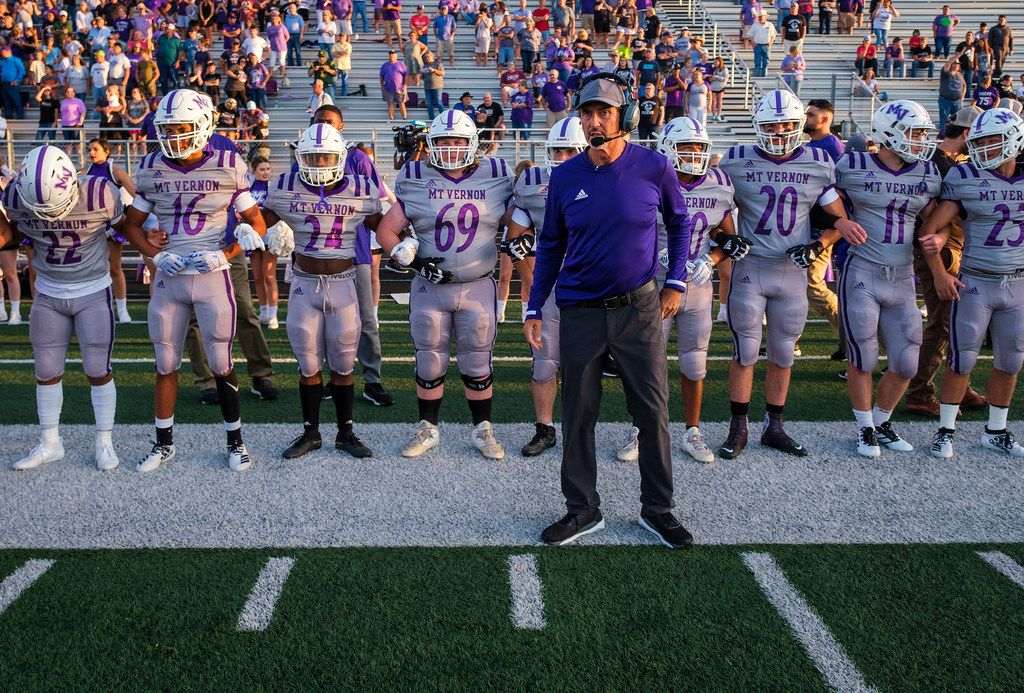 Mount Vernon High School football coach Art Briles stands in front of players on the sideline before his team's season-opening game Friday, Aug. 30, 2019, in Bonham, Texas. The away game against Bonham is the first game with Mount Vernon for Briles, the former Baylor coach.