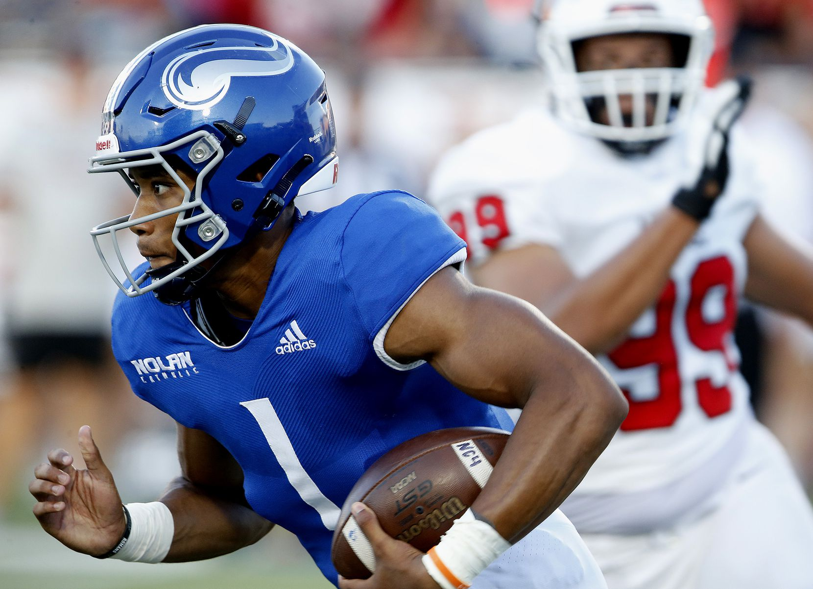 Nolan Catholic High School quarterback Tj Williams (1) carries the ball during the first half as Argyle High School hosted Nolan Catholic High School at Eagle Stadium in Allen on Saturday evening, August 28, 2021. (Stewart F. House/Special Contributor)