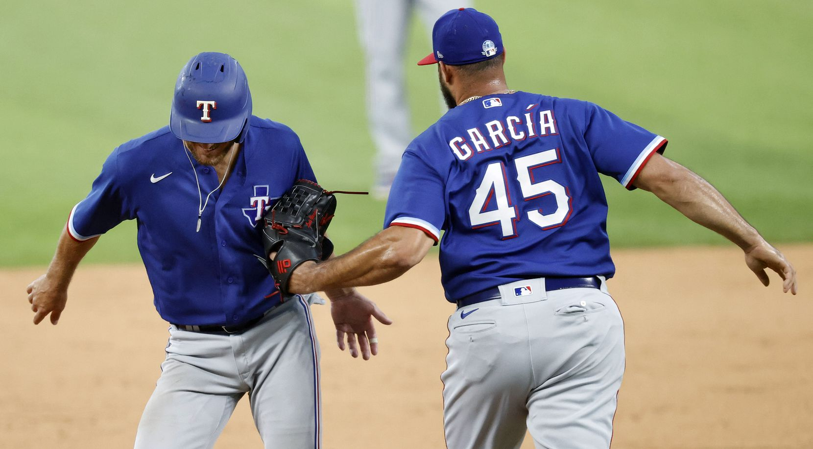 Texas Rangers Jeff Mathis is tagged out by pitcher Luis Garcia after being caught off second base during an intrasquad game at Summer Camp inside Globe Life Field in Arlington, Texas, Friday, July 10, 2020. (Tom Fox/The Dallas Morning News)
