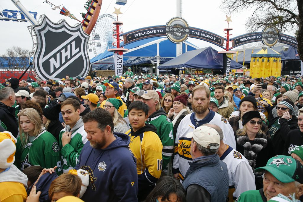 Fans work their way to the stadium entrance prior to a NHL Winter Classic matchup between the Dallas Stars and the Nashville Predators on Wednesday, January 1, 2020 at Cotton Bowl Stadium in Dallas. (Ryan Michalesko/The Dallas Morning News)