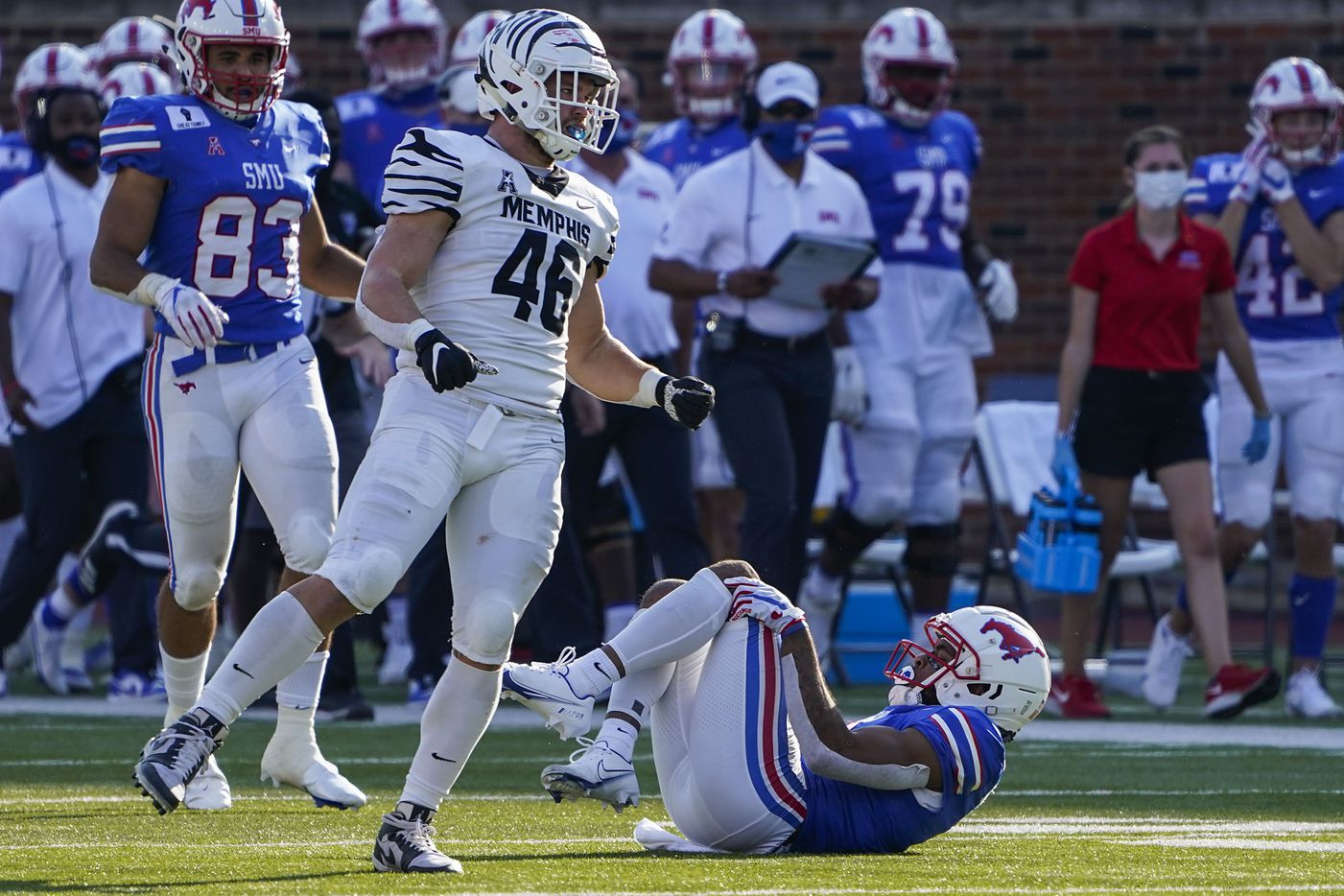 SMU wide receiver Reggie Roberson Jr. lies on the ground after being injured during the second half of an NCAA football game against Memphis at Ford Stadium on Saturday, Oct. 3, 2020, in Dallas.