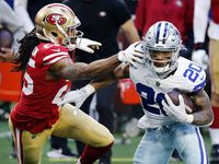 FILE - Cowboys running back Tony Pollard (20) breaks away from 49ers cornerback Richard Sherman (25) during the first quarter at AT&T Stadium in Arlington on Sunday, Dec. 20, 2020.