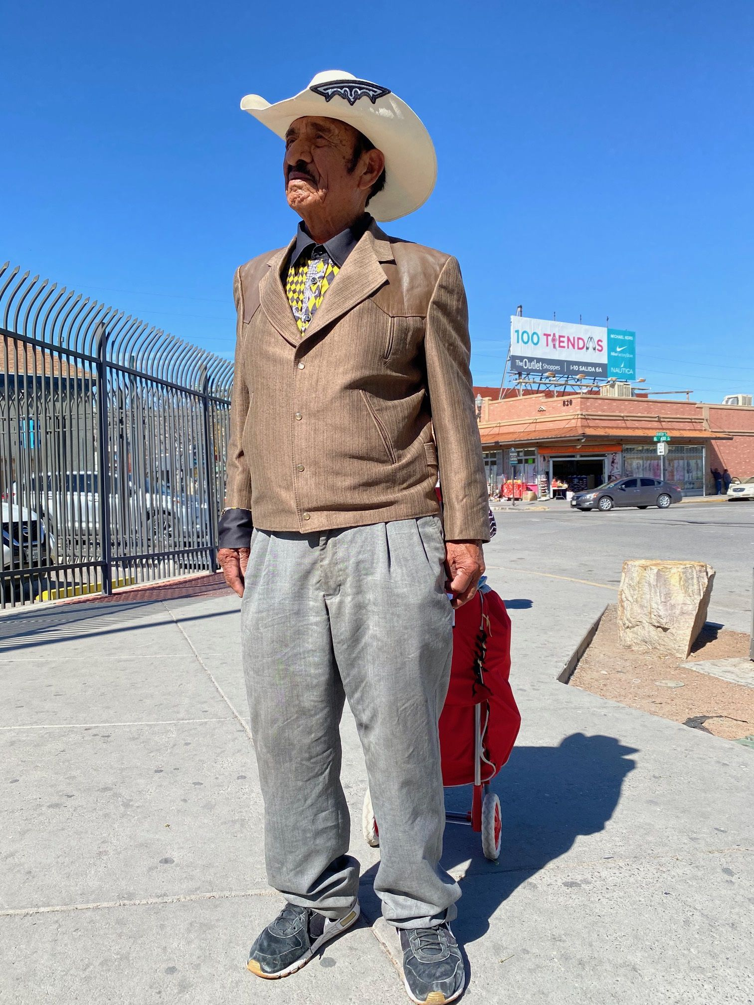 """Leonardo Alvarado, 87, a singer-songwriter, crosses back to Ciudad Juarez in Mexico. He-s thinking of writing a corrido, a form of ballad, about the coronavirus. """"Maybe I can help educate people about the seriousness,"""" he said."""