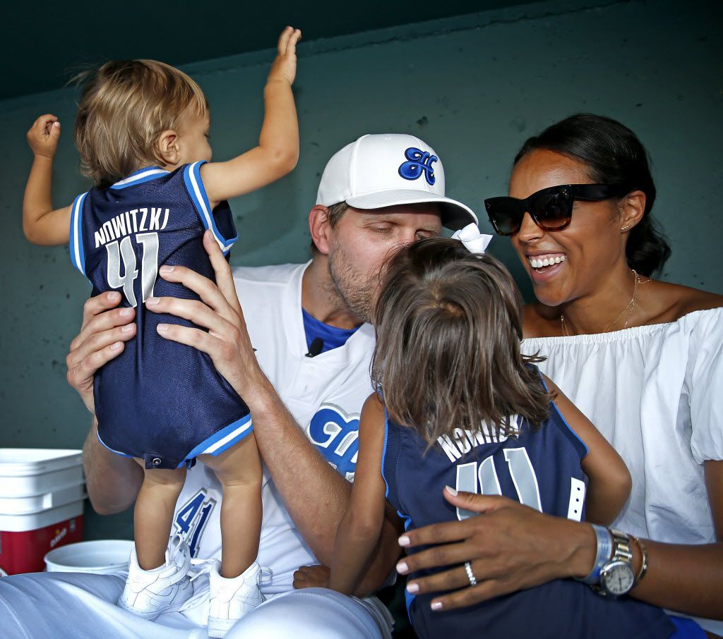 Dallas Mavericks Dirk Nowitzki kisses his 3-year-old daughter Malaika Nowitzki (second from right) as his wife Jessica Olsson (right) and son Max Nowitzki, 1, look on as the family poses for a photo in the dugout during the Dirk Nowitzki's 2016 Heroes Celebrity Baseball Game at Dr Pepper Ballpark on Friday, June 10, 2016, in Frisco, Texas. (Jae S. Lee/The Dallas Morning News)