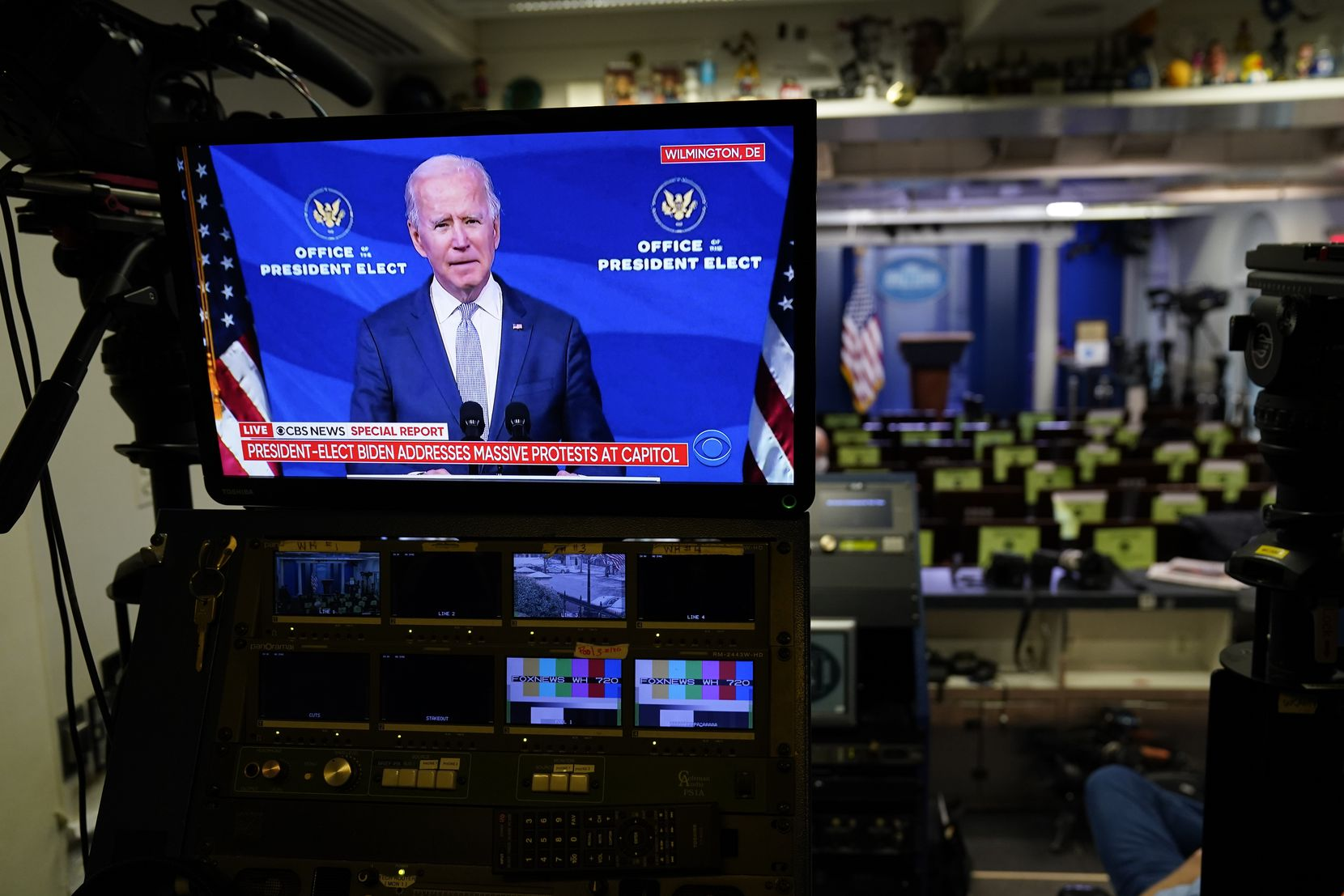 A screen in the briefing room of the White House in Washington displays a video of President-elect Joe Biden speaking in Wilmington, Del., Wednesday, Jan. 6, 2021. (AP Photo/Evan Vucci)