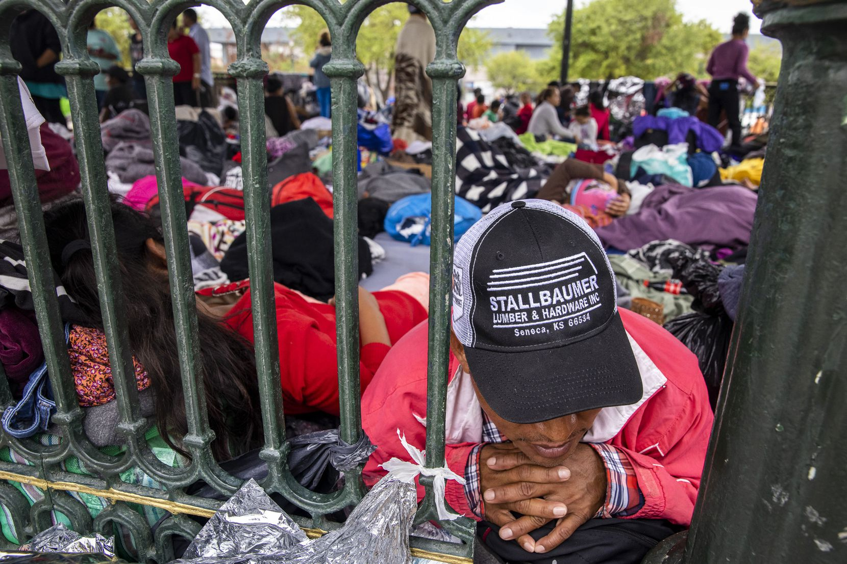 Laureano Sanchez, a migrant from Guatemala, lies among dozens of other expelled migrants sleeping in a gazebo in a public square in the Mexican border city of Reynosa.