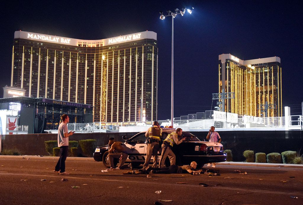 Las Vegas police stand guard along the streets outside the festival grounds of the Route 91 Harvest.