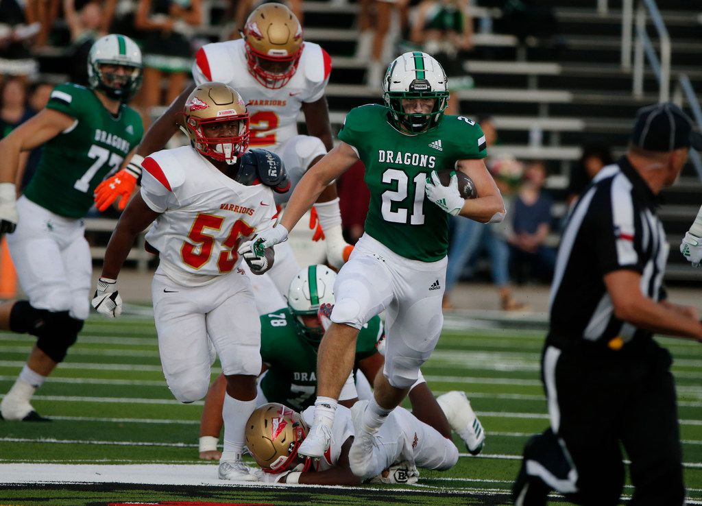 Southlake's Kannon Kadi (21) breaks away from South Grand Prairie defender Noah Williams (55) during the first half of their high school football game in Southlake Texas on August 30, 2019. (Michael Ainsworth/Special Contributor)