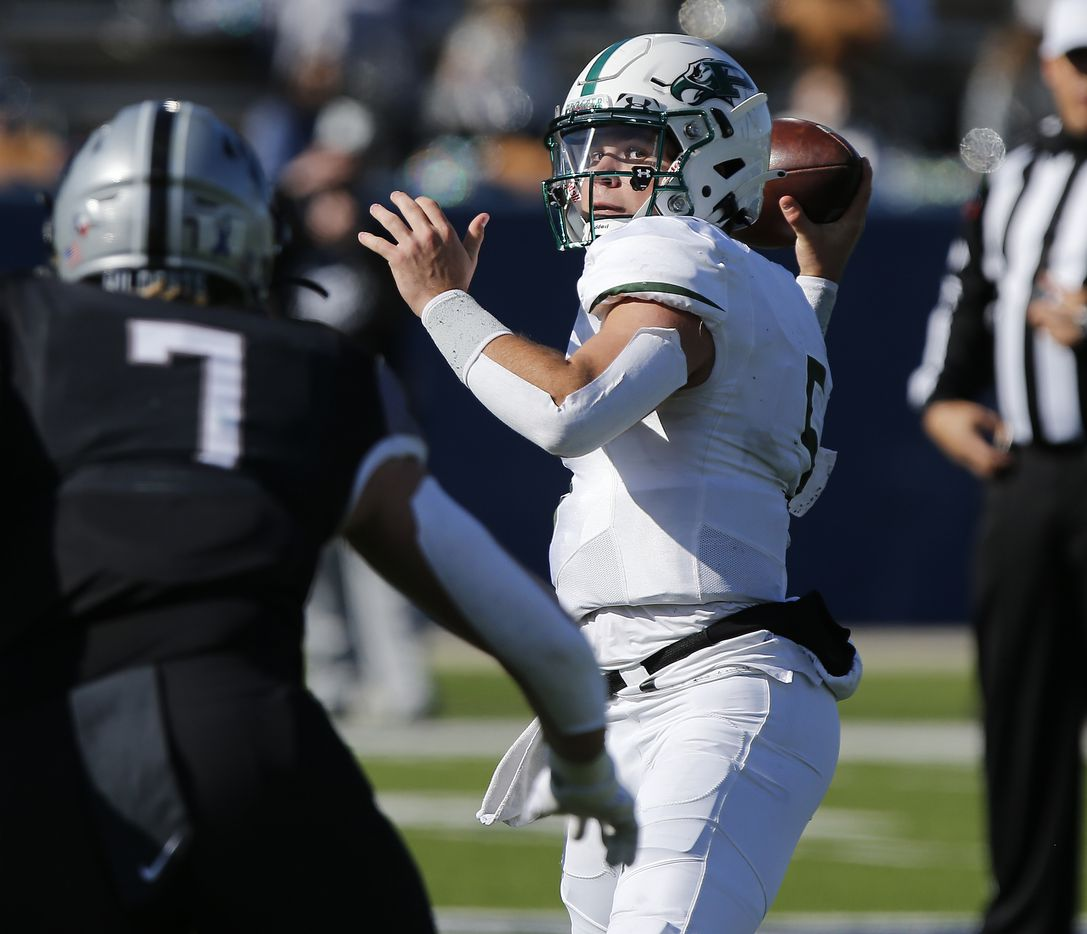 Prosper High School quarterback Jackson Berry (5) throws a pass under pressure from Denton Guyer High School defensive end Cooper Lanz (7) during the first half as Prosper High School played Denton Guyer High School in the Class 6A Division II, Region I final at McKinney ISD Stadium in McKinney on Saturday, January 2, 2021.  (Stewart F. House/Special Contributor)
