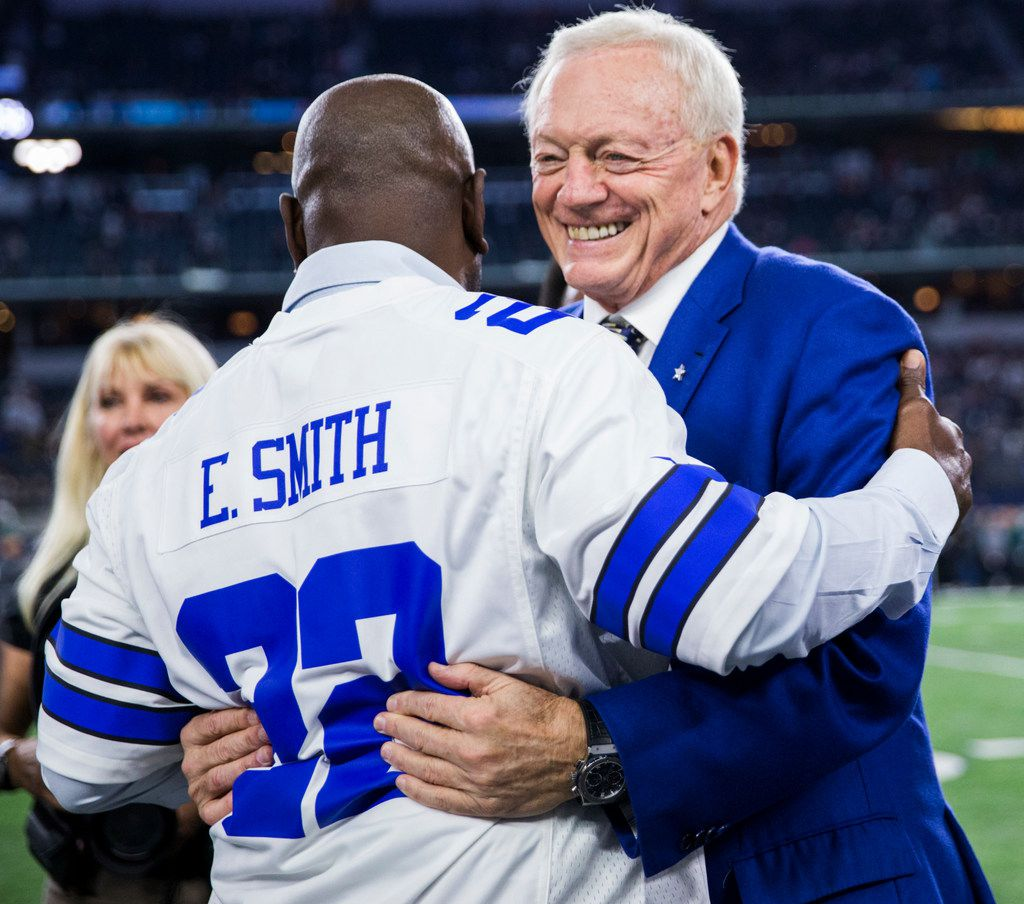 Dallas Cowboys owner Jerry Jones gets a hug from former Dallas Cowboys running back Emmitt Smith before an NFL game between the Dallas Cowboys and the Philadelphia Eagles on Sunday, November 19, 2017 at AT&T Stadium in Arlington, Texas. The 1992 Super Bowl championship Dallas Cowboys team was honored before the game. (Ashley Landis/The Dallas Morning News)