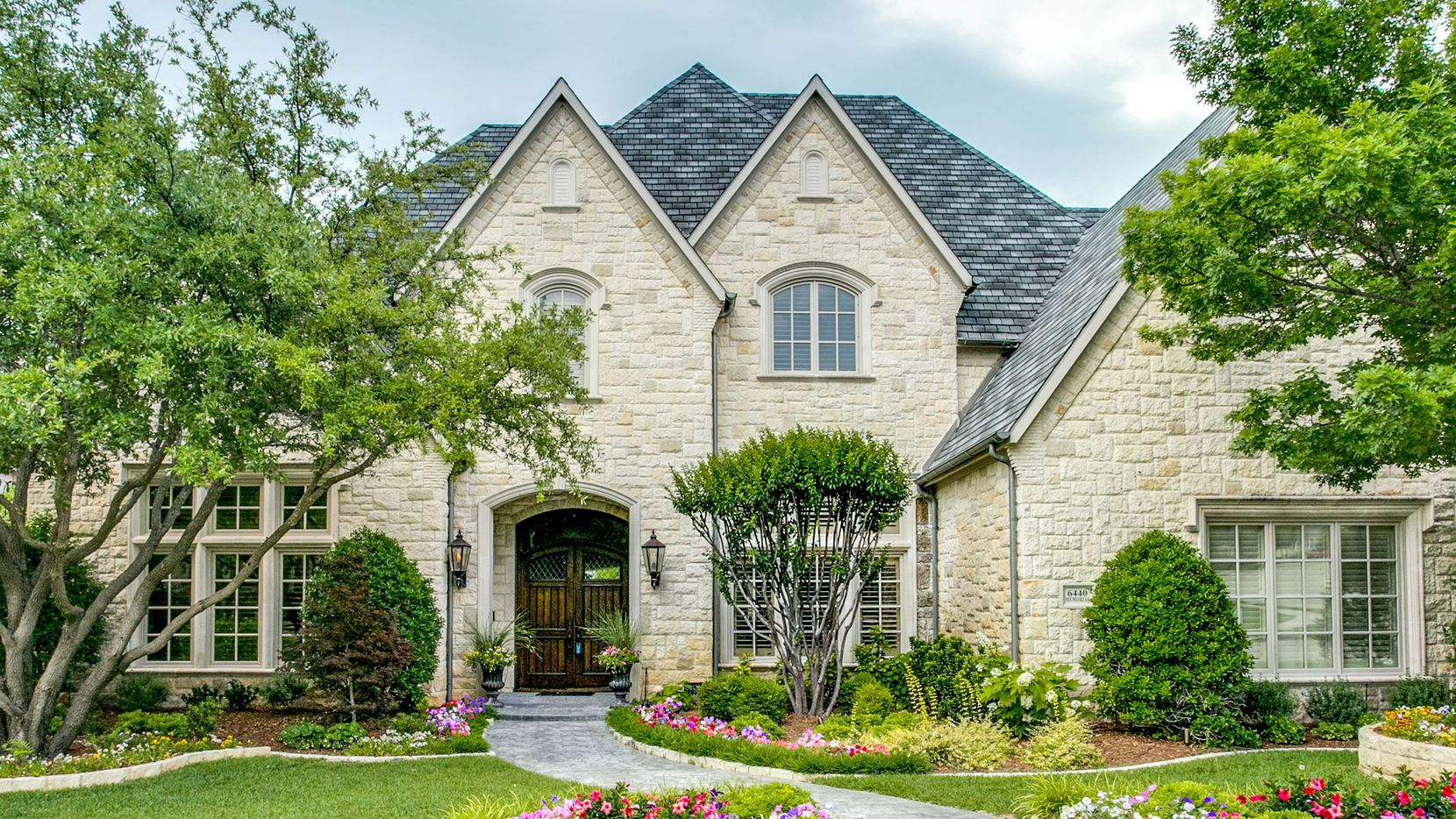 Offered for $1,688,800, the estate at 6440 Memorial Drive in Frisco backs to a greenbelt and creek.