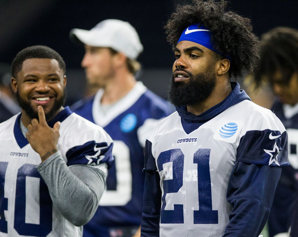 Dallas Cowboys running back Mike Weber (40) talks with running back Ezekiel Elliott (21) during a Dallas Cowboys OTA practice on Wednesday, May 29, 2019 at The Star in Frisco. (Ashley Landis/The Dallas Morning News)