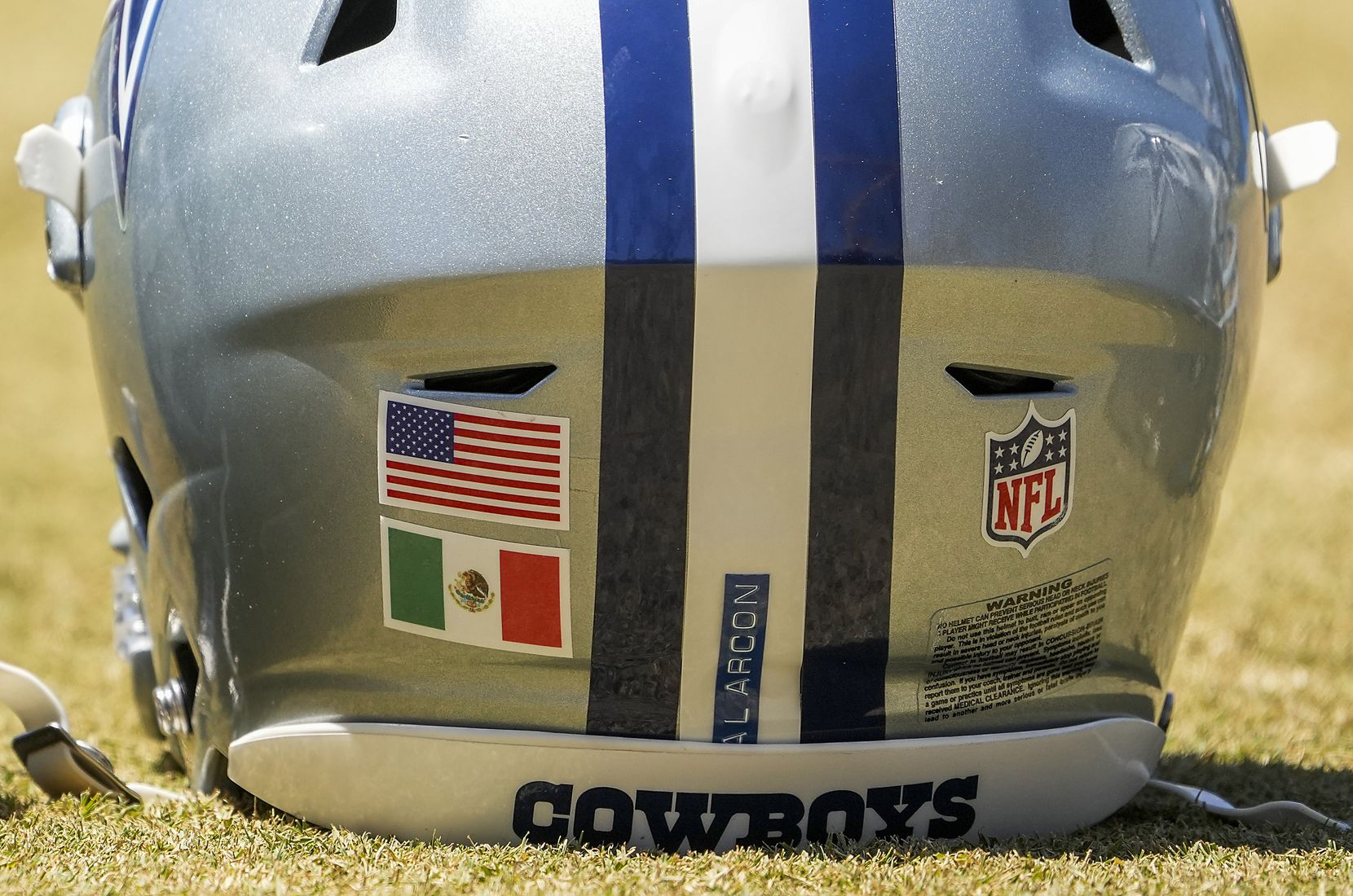 The helmet of Dallas Cowboys tackle Isaac Alarcón (60) features flags of both the United States and Mexico during a practice at training camp on Tuesday, Aug. 3, 2021, in Oxnard, Calif.