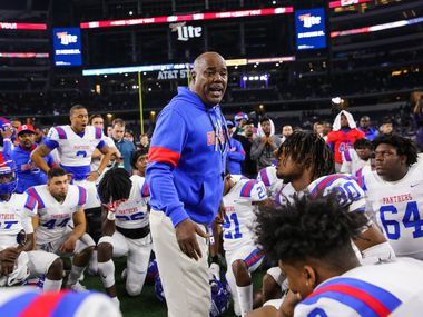 Duncanville's coach Reginald Samples consoles speaks to his team after losing a Class 6A Division I state championship game against North Shore at the AT&T Stadium in Arlington, on Saturday, December 21, 2019. North Shore won 31-17. (Juan Figueroa/The Dallas Morning News)