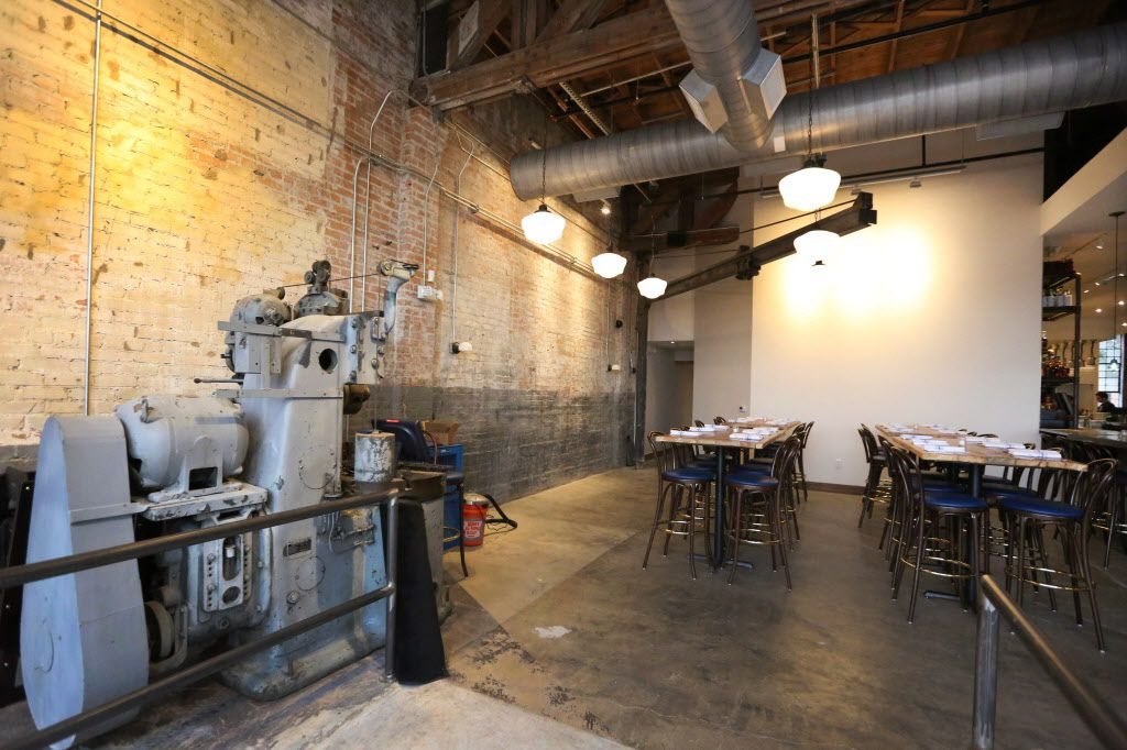 Vintage industrial equipment stands on the floor in the dining area at the new restaurant, Filament, at 2626 Main Street in Deep Ellum in Dallas, photographed on Tuesday, December 1, 2015. (Louis DeLuca/The Dallas Morning News)