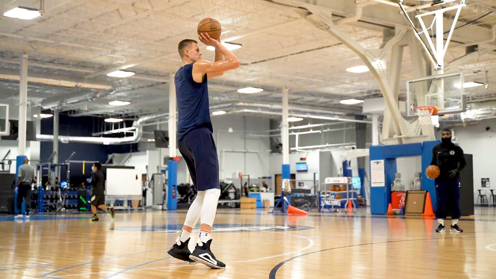 FILE - Mavericks forward Kristaps Porzingis takes some shots during a workout on July 1, 2020, when Porzingis and others played at the team's practice facility in Dallas for the first time since the coronavirus pandemic started.