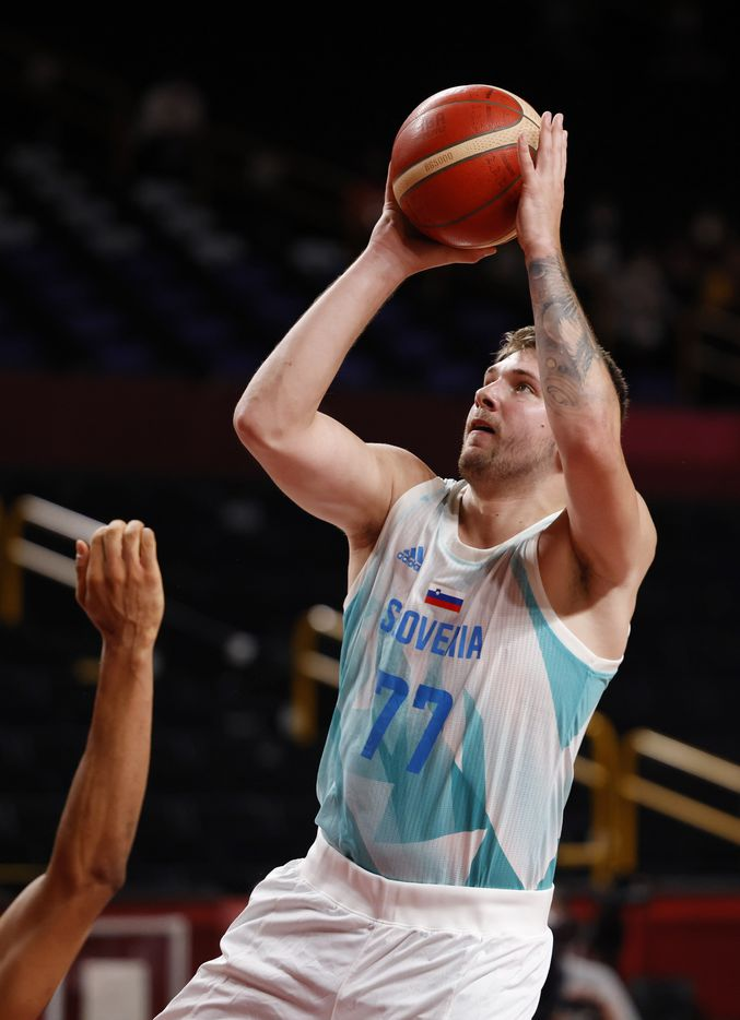 Slovenia's Luka Doncic (77) attempts a shot in a game against Germany during the first half of play of a quarter final basketball game at the postponed 2020 Tokyo Olympics at Saitama Super Arena, on Tuesday, August 3, 2021, in Saitama, Japan. (Vernon Bryant/The Dallas Morning News)