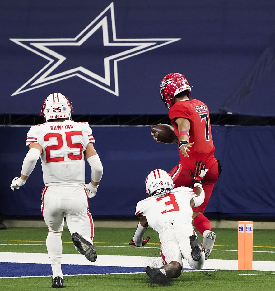 Cedar Hill quarterback Kaidon Salter (7) gets past Katy defensive back Bobby Taylor (3) and Shepherd Bowling (25) for a 10-yard touchdown during the second half of the Class 6A Division II state football championship game at AT&T Stadium on Saturday, Jan. 16, 2021, in Arlington, Texas. Katy won the game 51-14.