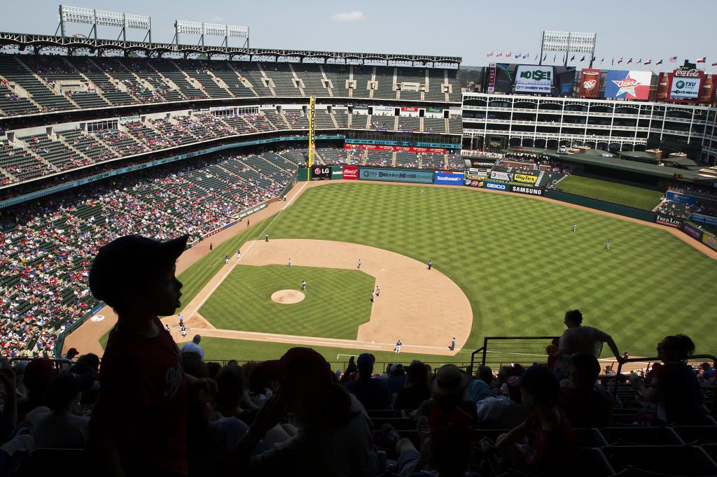 Texas Rangers fans find shade at the top of the stadium as they watch a game against the Chicago White Sox at Globe Life Park on Wednesday, May 11, 2016, in Arlington. The Rangers won the game 6-5.  (Smiley N. Pool/The Dallas Morning News)