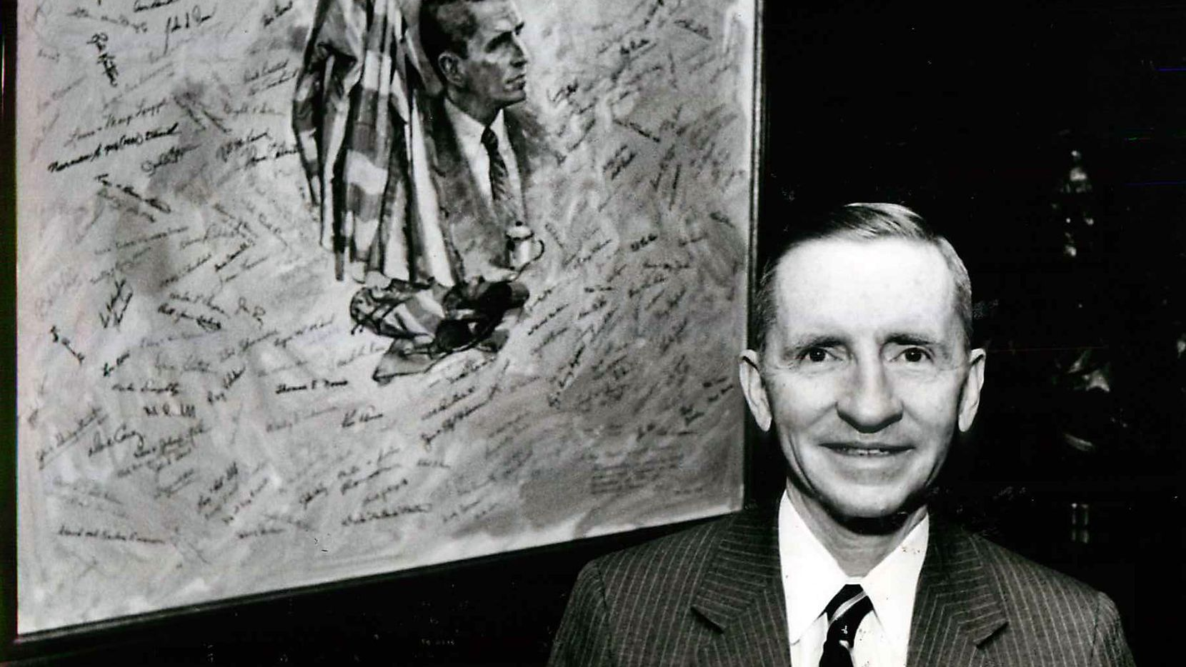 H. Ross Perot stands outside his office beside a painting autographed by many of the POWs he has helped. Helping POWs and improving Texas education were two of his main pet causes.