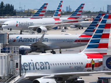 American Airlines aircraft are parked at their gates at Miami International Airport in Miami.