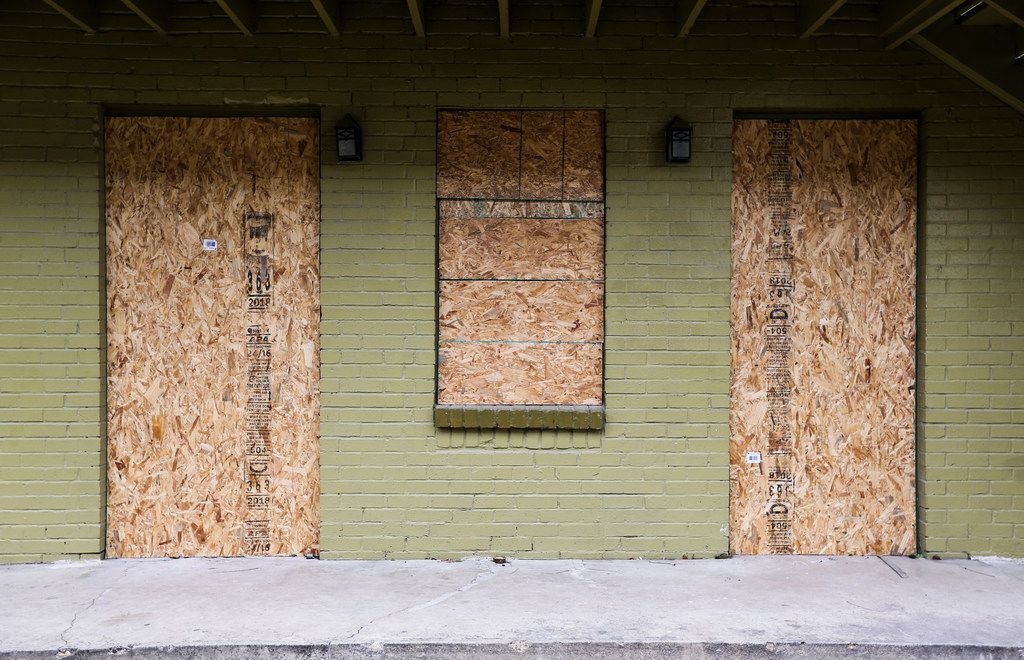 Vacant apartments are boarded up, long after squatters were booted out of Bryan Song Apartments.