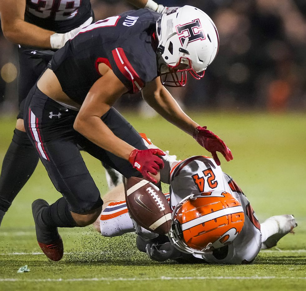 Rockwall-Heath wide receiver Fletcher Fierro (9) recovers a fumble by teammate Jordan Nabors as he fights for the loose ball with Rockwall defensive back Will Rakow (24) during the second half of a District 10-6A high school football game at Wilkerson-Sanders Stadium on Friday, Sept. 24, 2021, in Rockwall.  Rockwall-Heath won the game 79-71 in double overtime.