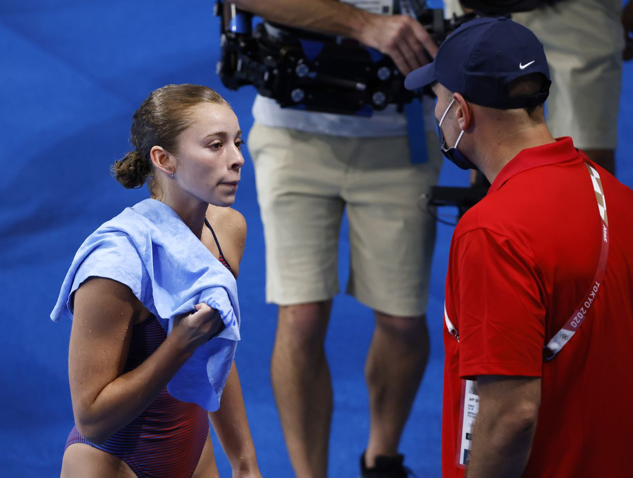 USA's Hailey Hernandez talks to coach Jeff Bro after completing a dive in the women's 3 meter springboard preliminary competition during the postponed 2020 Tokyo Olympics at Tokyo Aquatics Centre, on Friday, July 30, 2021, in Tokyo, Japan. Hernandez scored a total of 309.55 points to qualify for the next round. (Vernon Bryant/The Dallas Morning News)