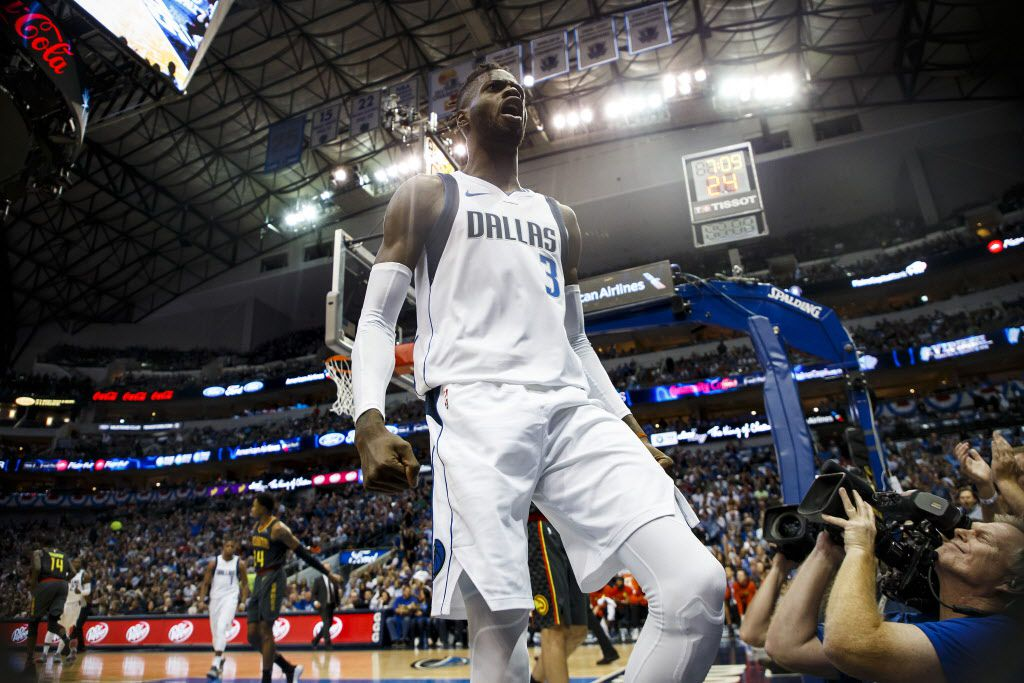Dallas Mavericks forward Nerlens Noel (3) celebrates after dunking the ball past Atlanta Hawks forward Kent Bazemore during the first half of an NBA basketball game at American Airlines Center on Wednesday, Oct. 18, 2017, in Dallas. (Smiley N. Pool/The Dallas Morning News)